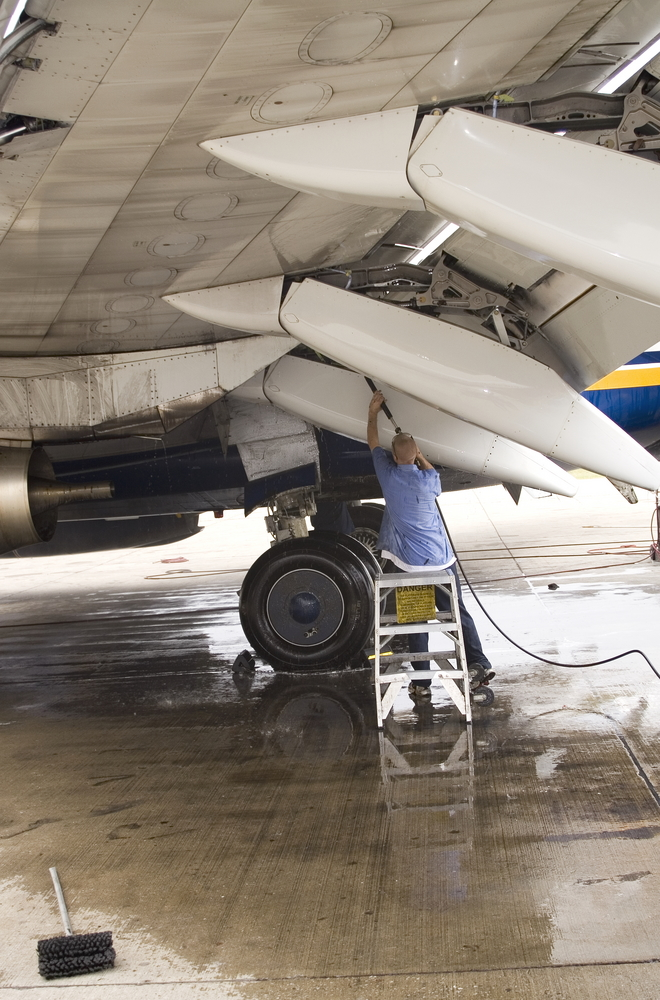 Washing the wings of an aircraft.