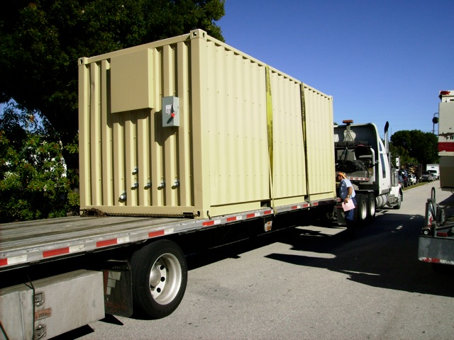Transporting an equipment room on a flat bed truck.