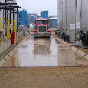 Truck entering wash bay containment pads